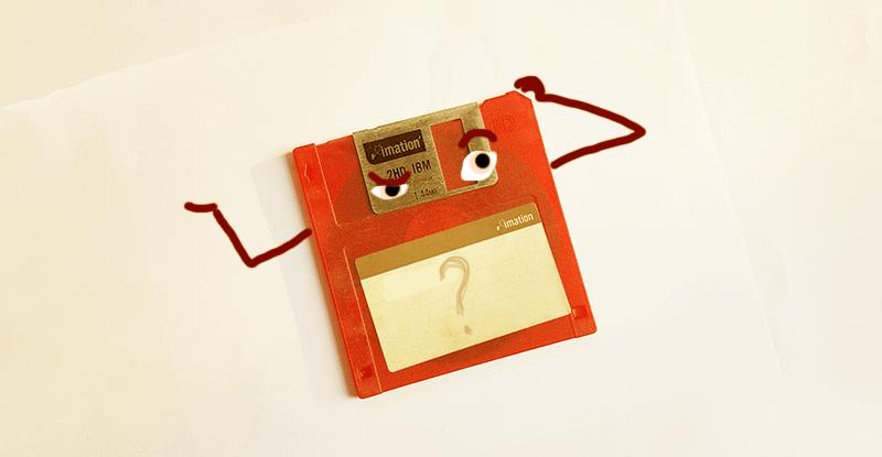 Kreslená disketa s výrazom tváre, ktorý naznačuje, že si nič nepametá