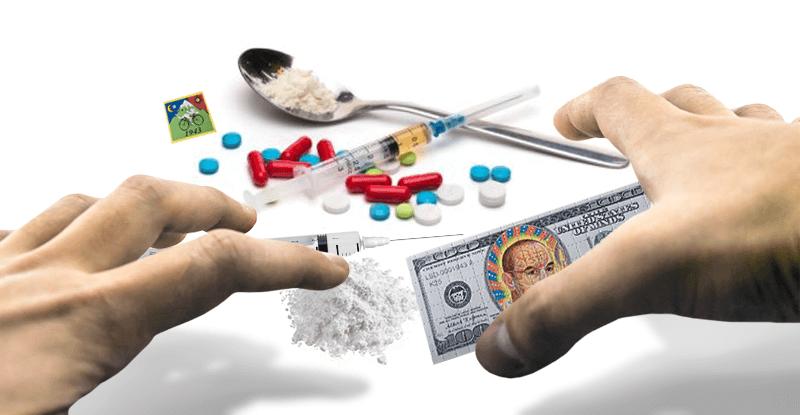 mužské ruky siahajúce po trvdých drogách